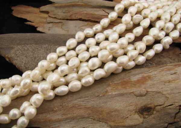 white elongated nugget freshwater pearls