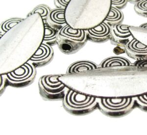 silver fancy oval feature beads